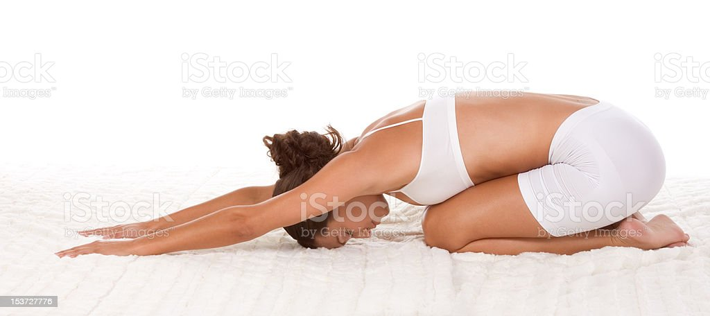 yoga pose - female in sport clothes performing exercise stock photo