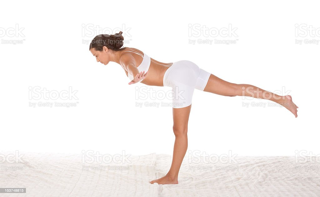 yoga pose - female in sport clothes performing exercise royalty-free stock photo