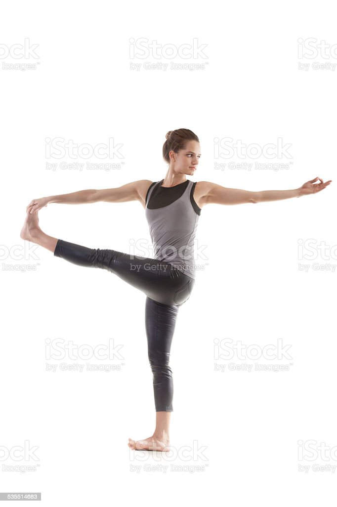 Yoga pose parivritta hasta padangushthasana stock photo