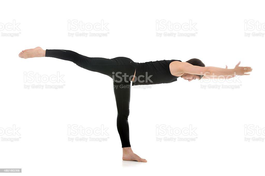 Yoga Pose Warrior 3 stock photo