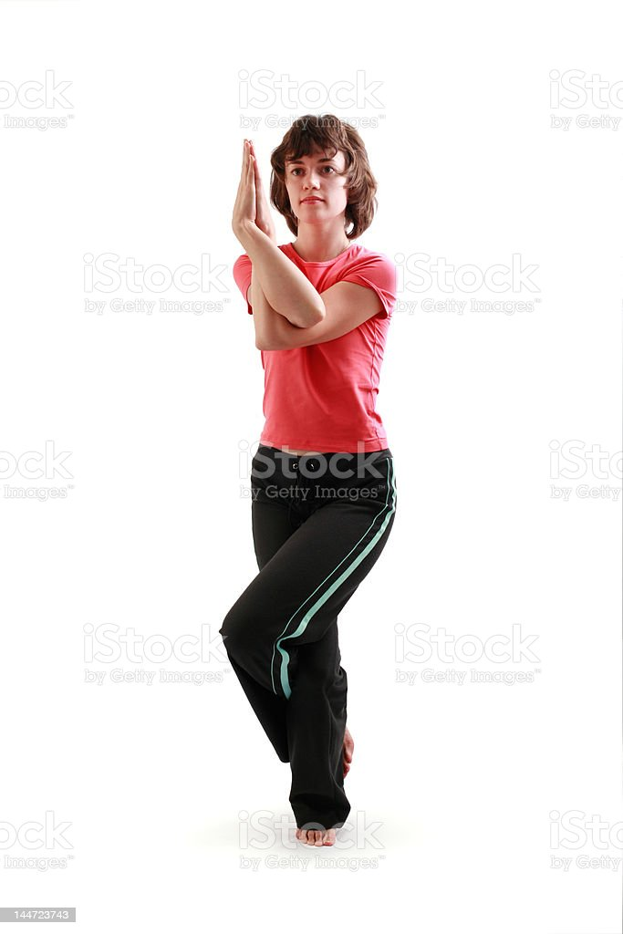 Yoga poses series. The Eagle Pose. Garuda-asana royalty-free stock photo