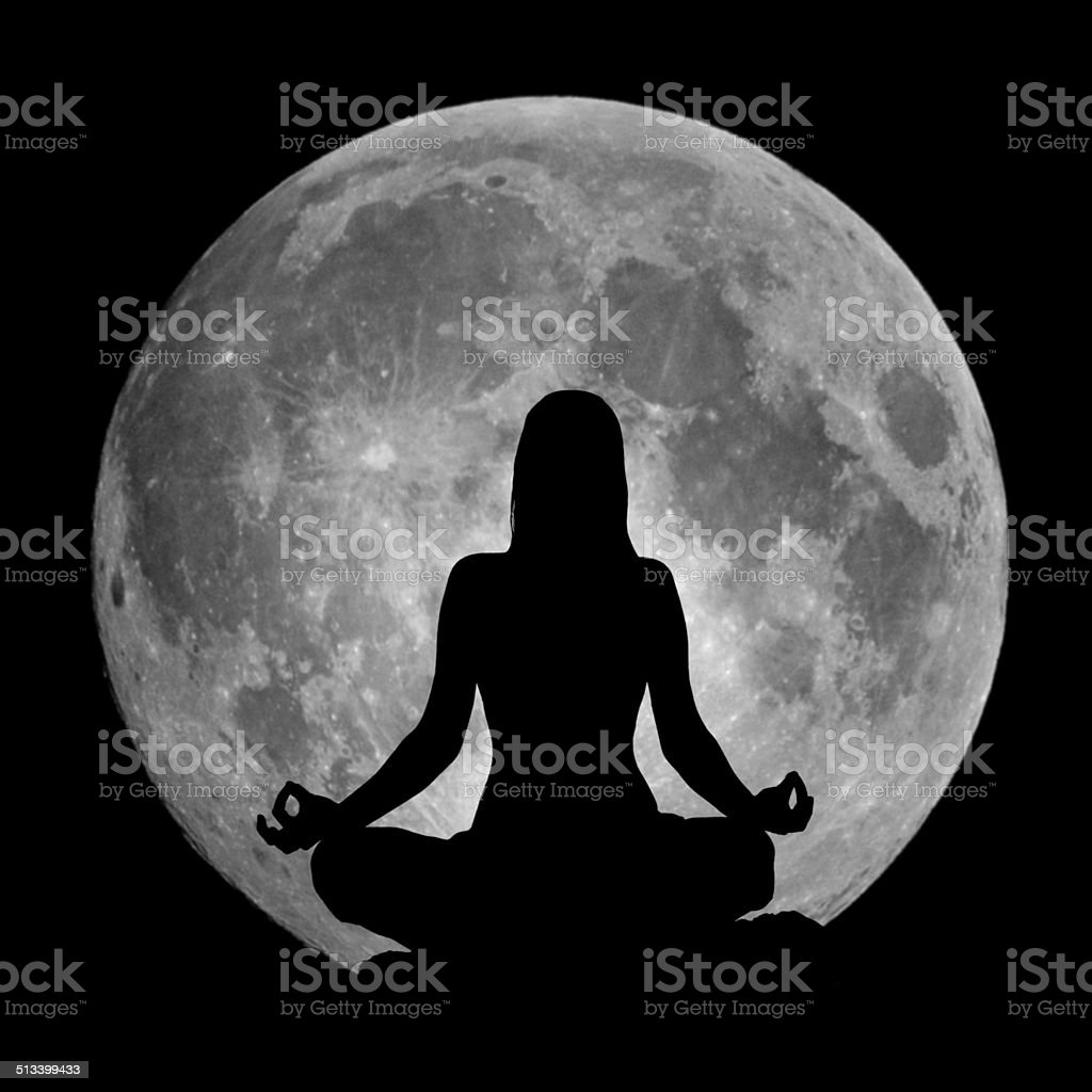 Yoga position silhouette against the Moon stock photo