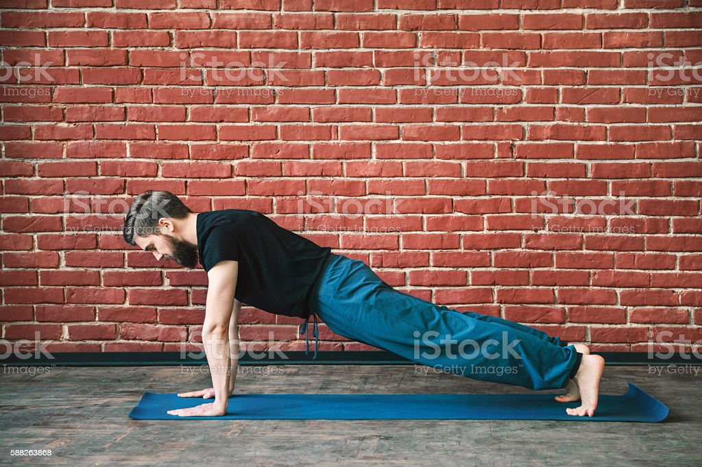 Yoga positions at wall background stock photo