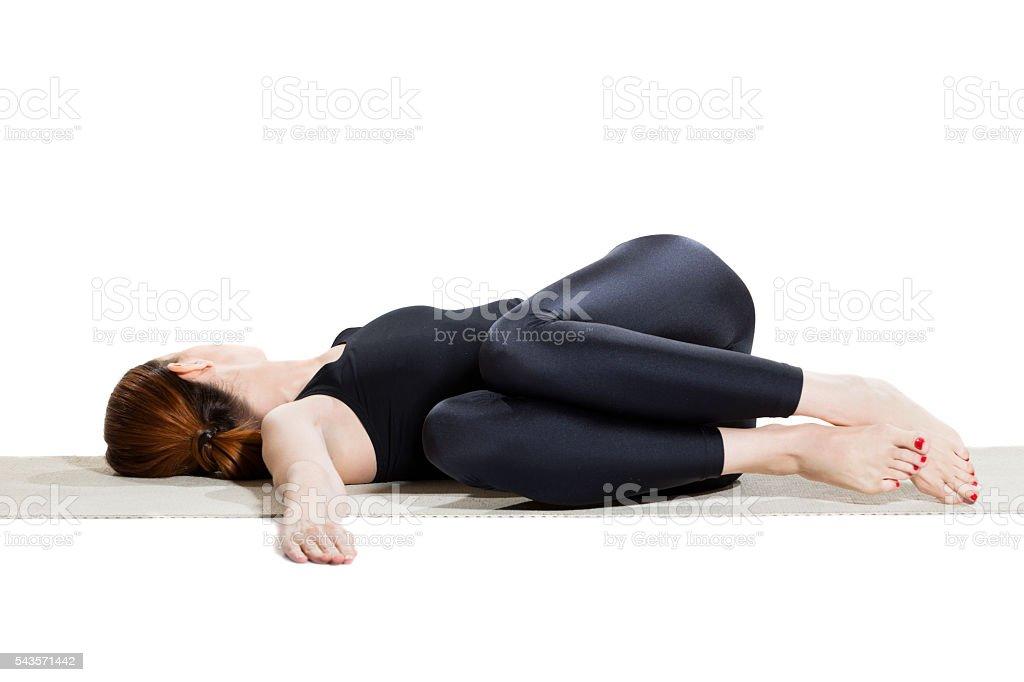 Yoga Reclining Twist Pose - Jathara Parivartaranasana stock photo