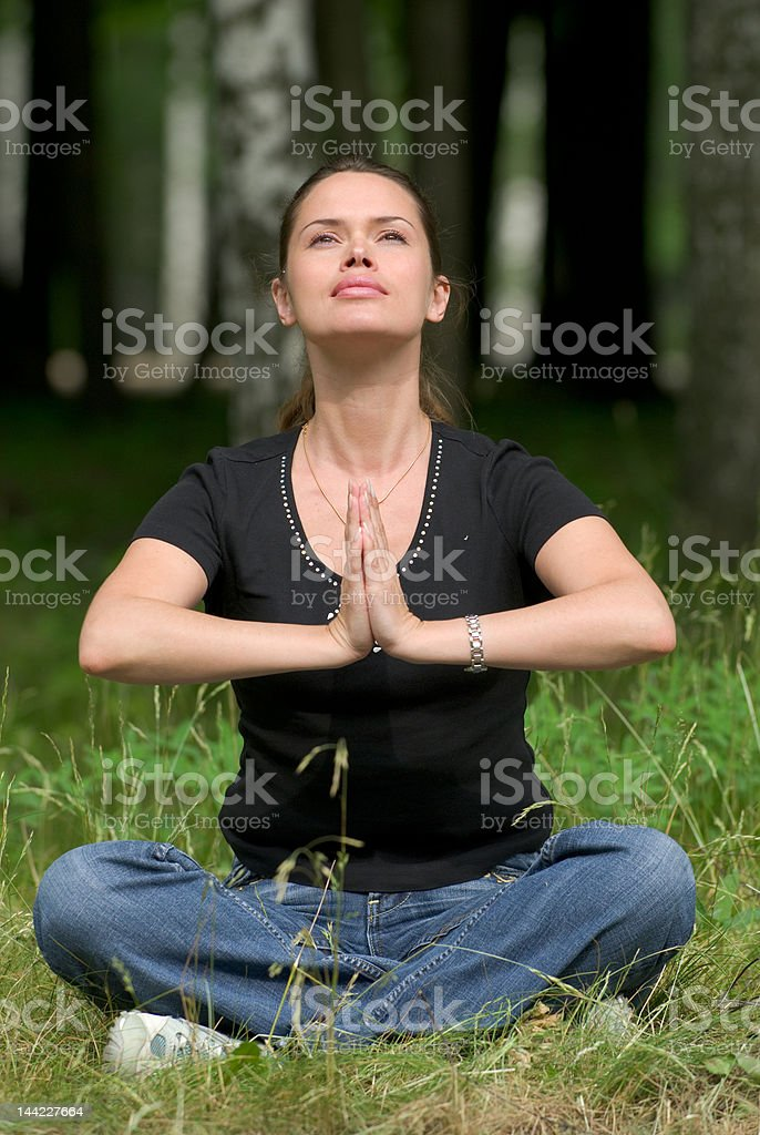 Yoga recreational exercise in a park royalty-free stock photo