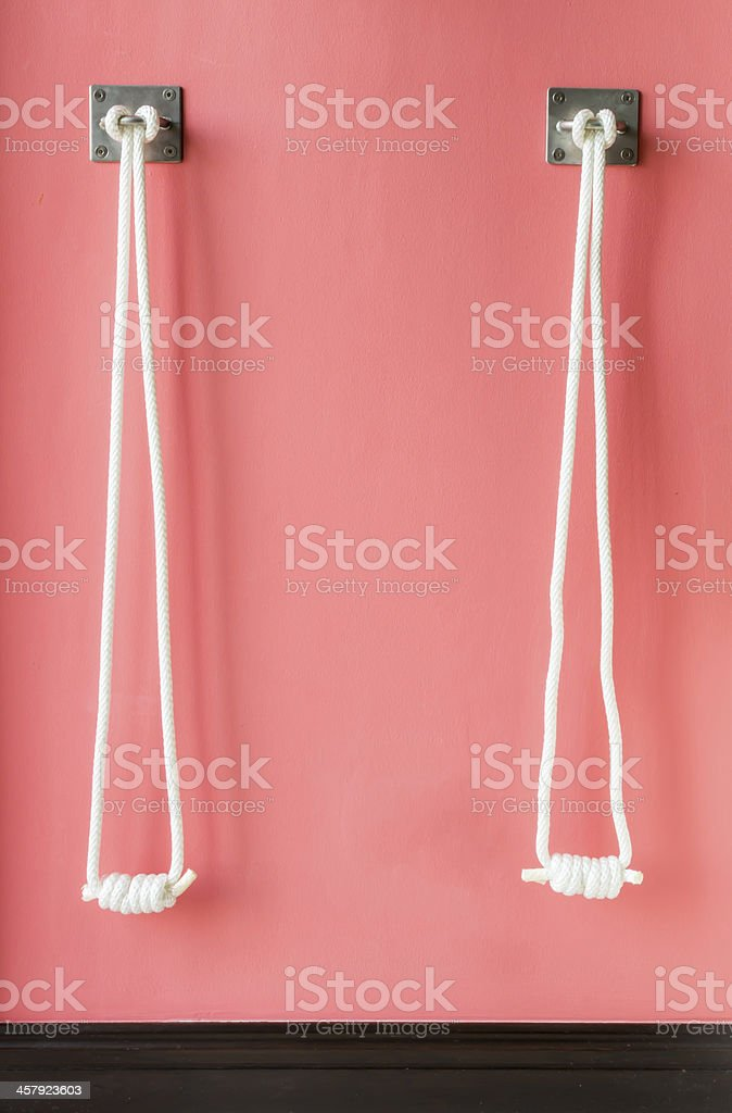 Yoga rope equipment on a wall stock photo