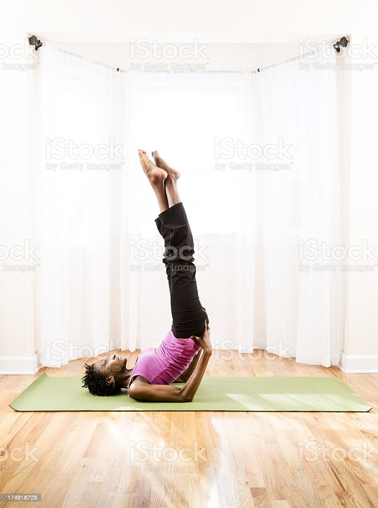Yoga, Salamba Sarvangasana or shoulder stand royalty-free stock photo