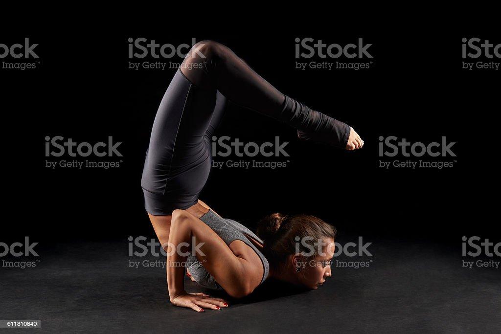 Yoga scorpion pose stock photo