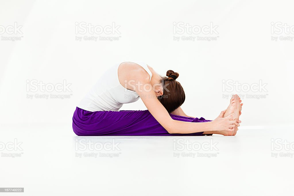 Yoga - Seated Forward Bend stock photo