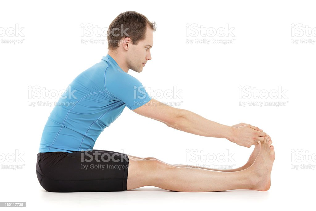 Yoga Seated Forward Bend position one stock photo