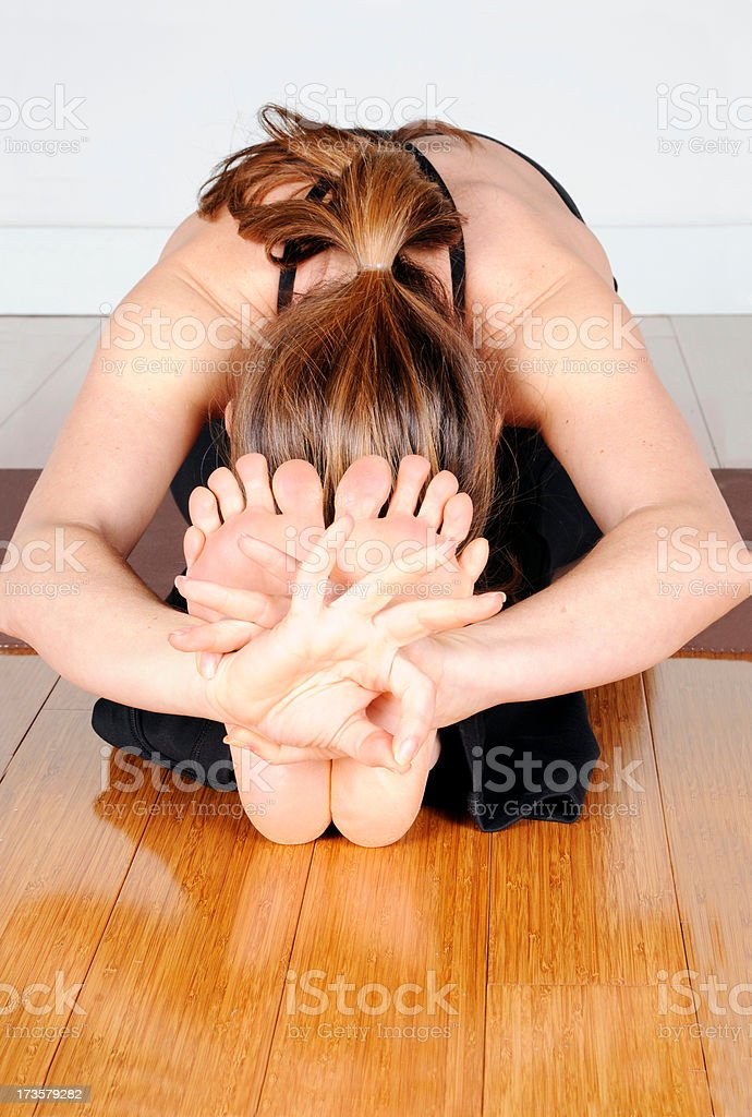 Yoga Series: Bent Stretch royalty-free stock photo