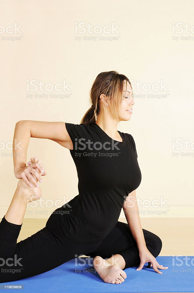 Yoga Series: Leg Stretch in Profile royalty-free stock photo