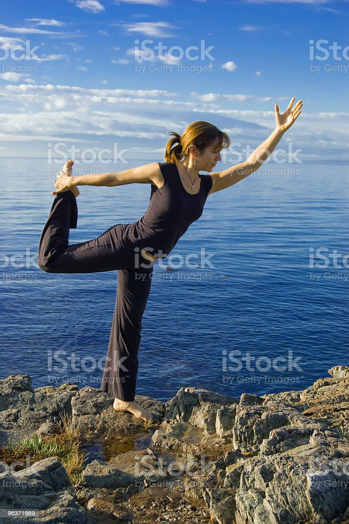Yoga Series - Ocean King of the Dance pose (Nataraja) royalty-free stock photo