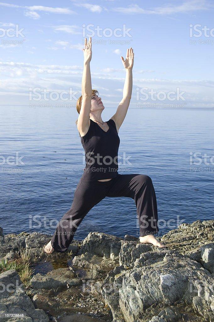 Yoga Series - Ocean Warrior 1 Pose (Virabhadra) stock photo