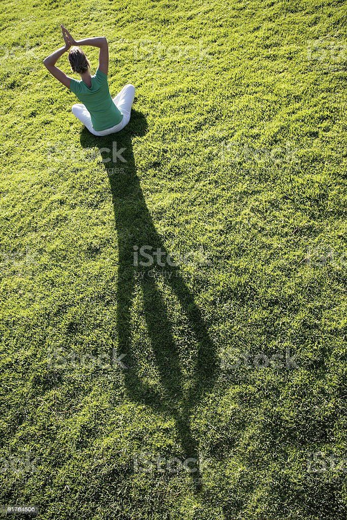 Yoga Shadow on Grass royalty-free stock photo