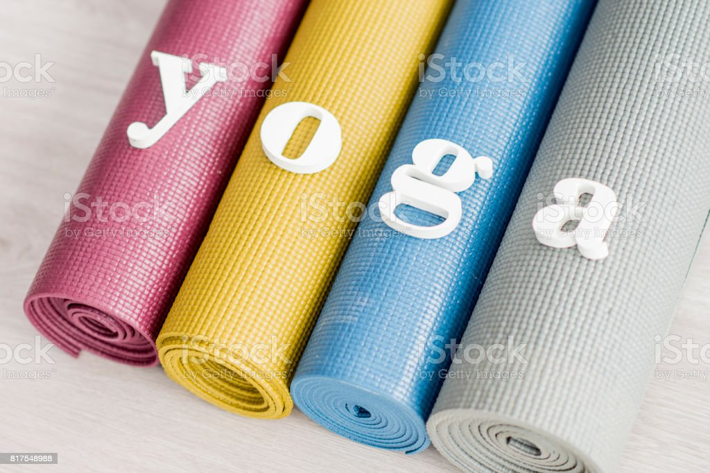 Yoga Spelled on Mats stock photo