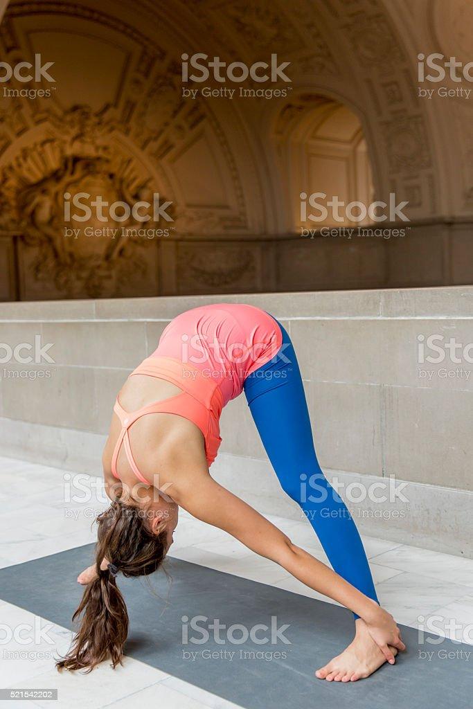 Yoga Standing Downward Dog stock photo