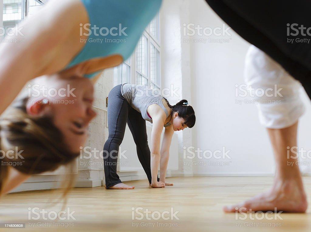 Yoga Student in forward bending pose stock photo