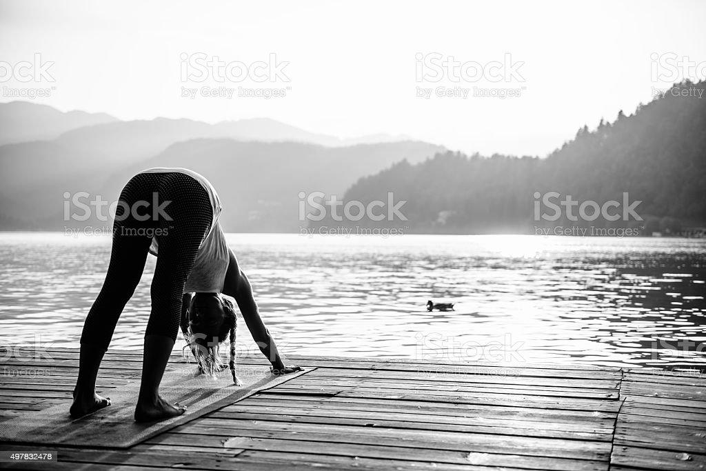 Yoga, sun salutation, downward facing dog, black and white stock photo