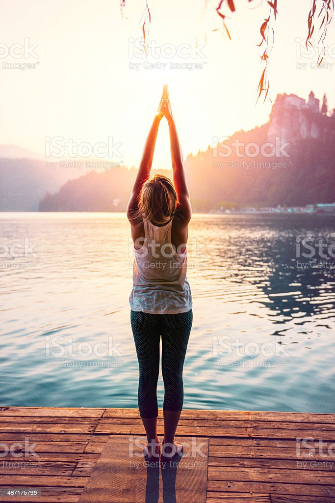 Yoga Sun Salutation stock photo