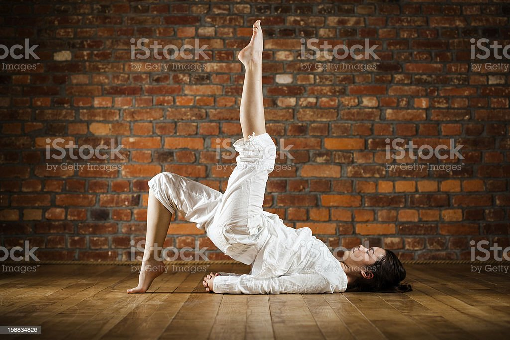 Yoga - teenage girl exercising royalty-free stock photo