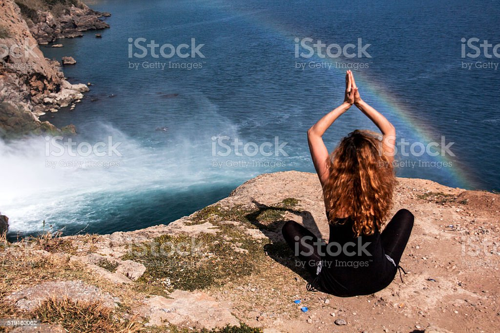 Yoga that women and rainbow. stock photo