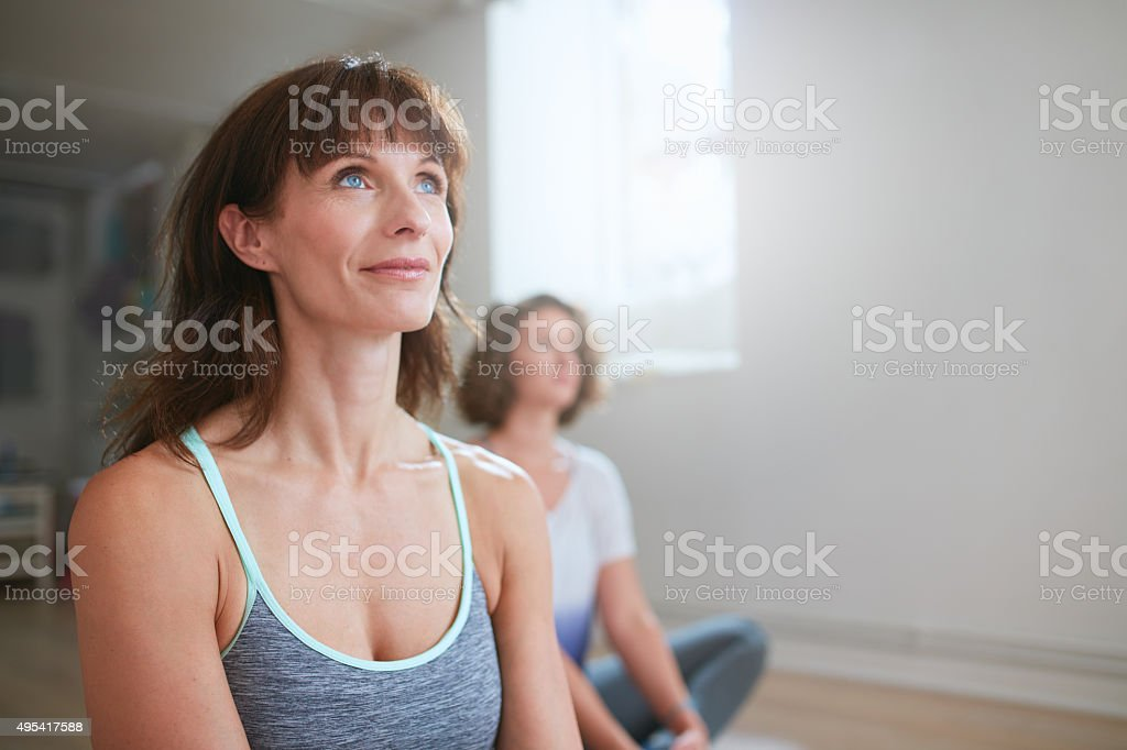 Yoga trainer during workout session in gym stock photo