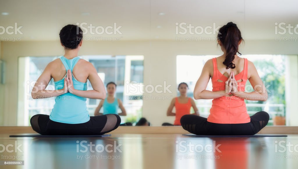Yoga training in lotus action with back side stock photo