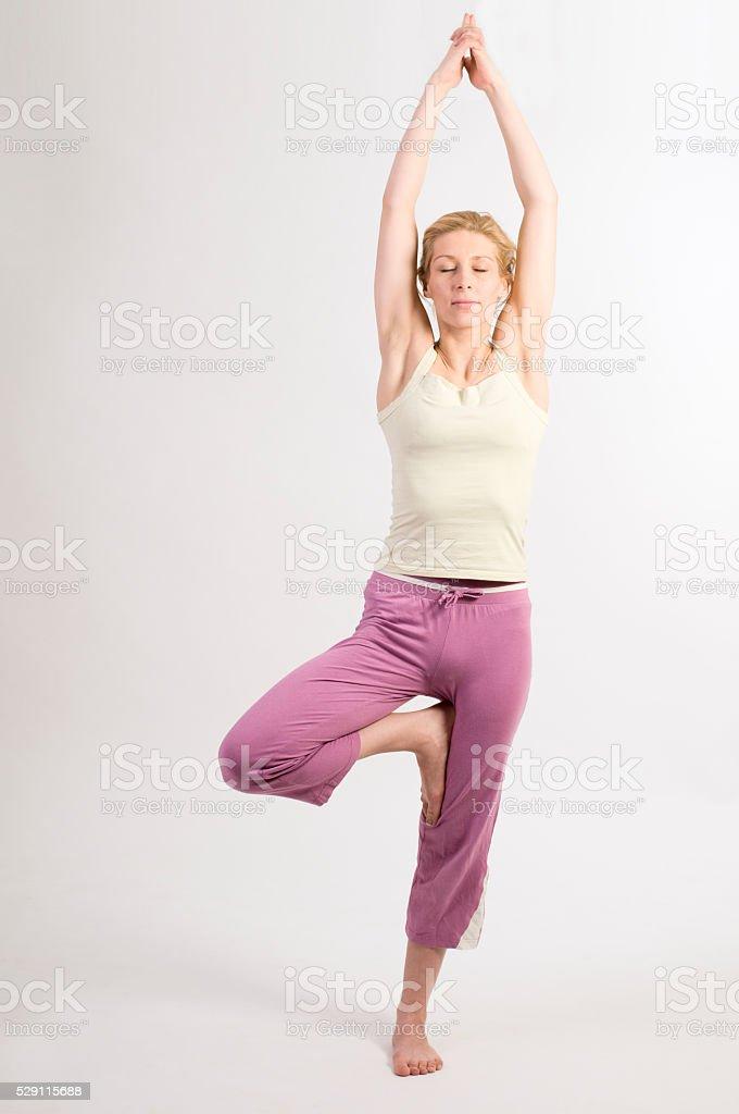 yoga tree three closed eyes stock photo
