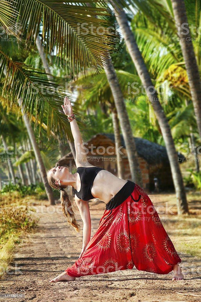 Yoga trikonasana triangle pose royalty-free stock photo
