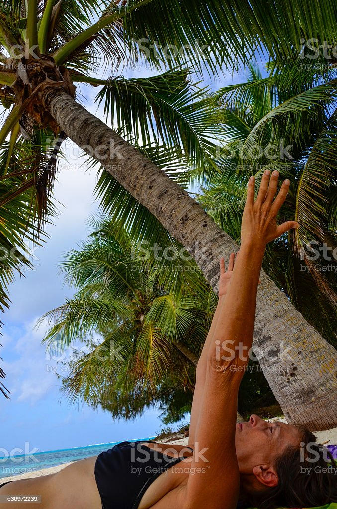 Yoga under Coconut Palm stock photo
