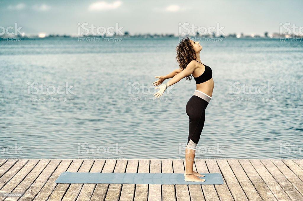Yoga urdhvahastasana stock photo