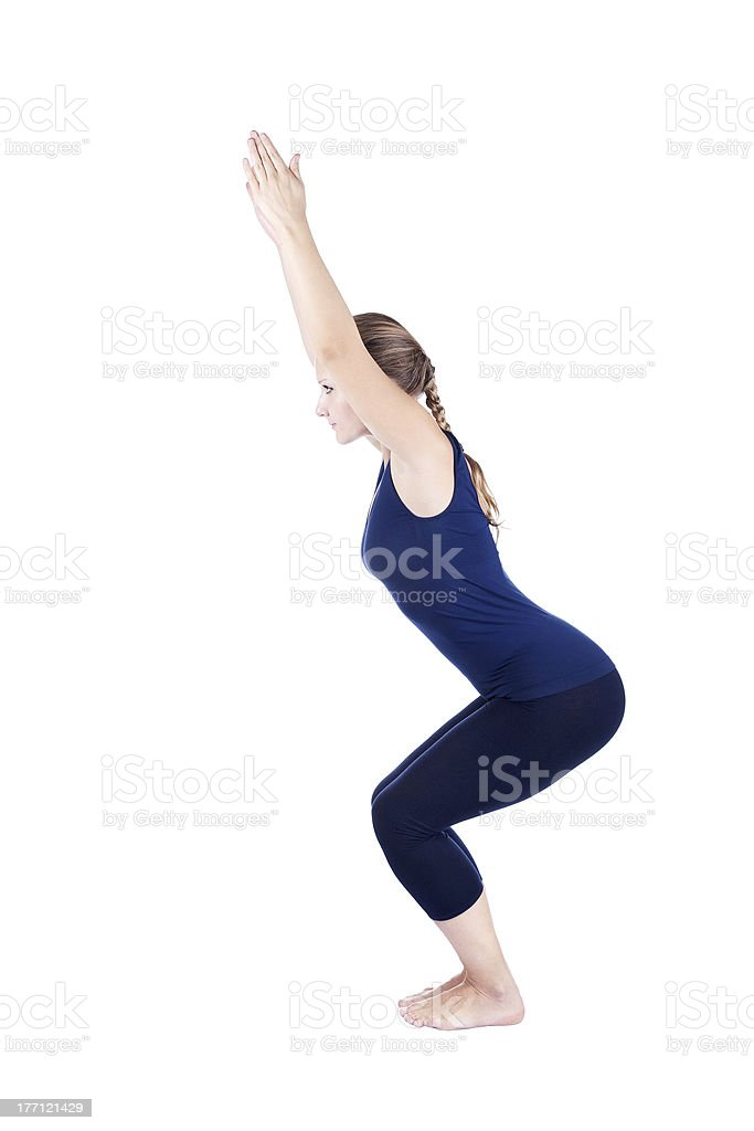 Yoga utkatasana chair powerful pose stock photo