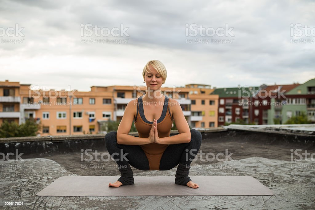 Yoga- Utkatasana/Buddhist stupa pose stock photo