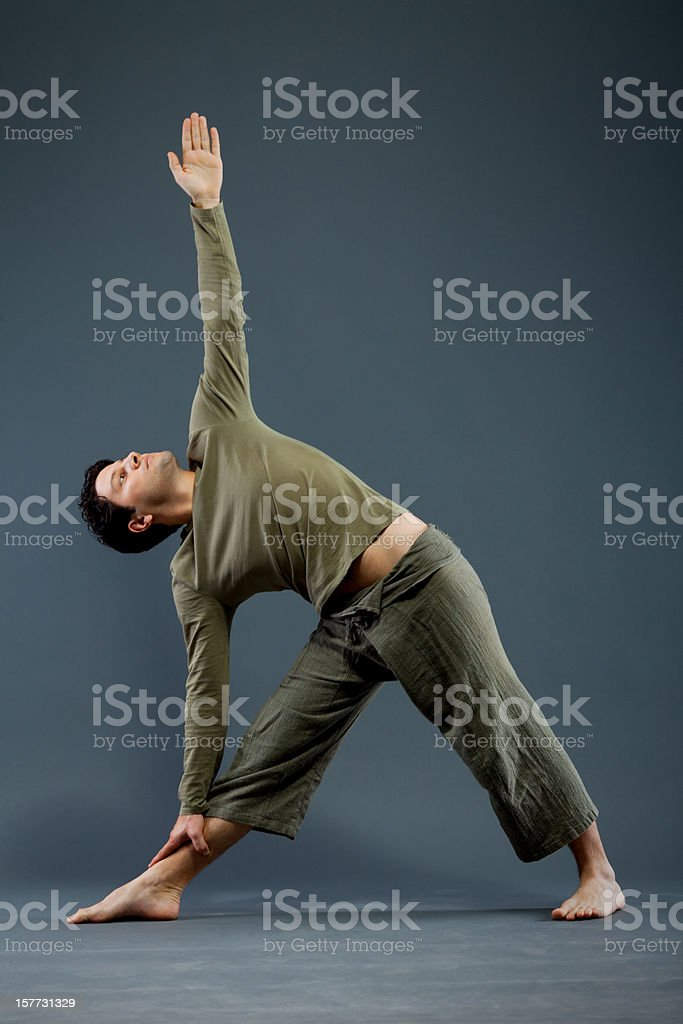Yoga - Utthita Trikonasana stock photo