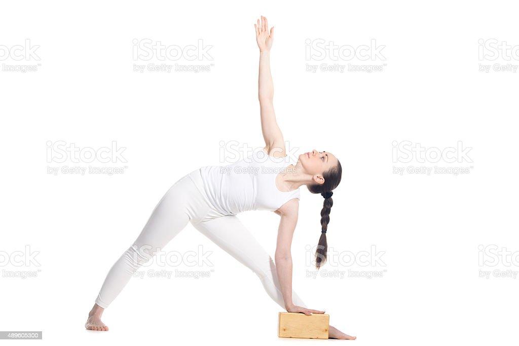 Yoga Utthita Trikonasana Pose with props stock photo