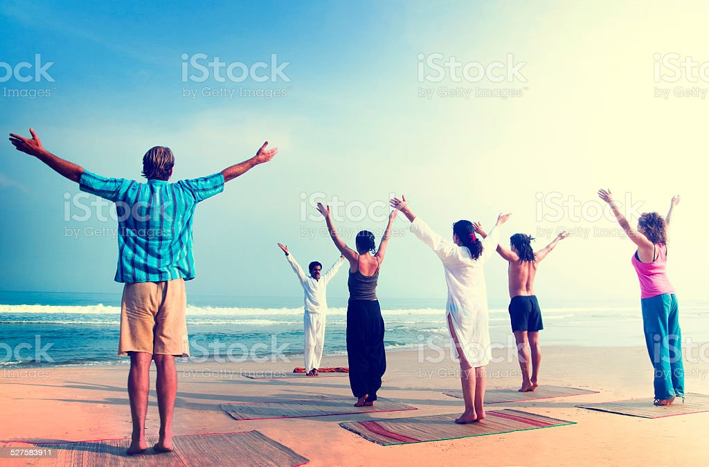 Yoga Wellbeing Exercise Beach Concept stock photo