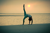 Yoga Wheel Pose at Sunrise