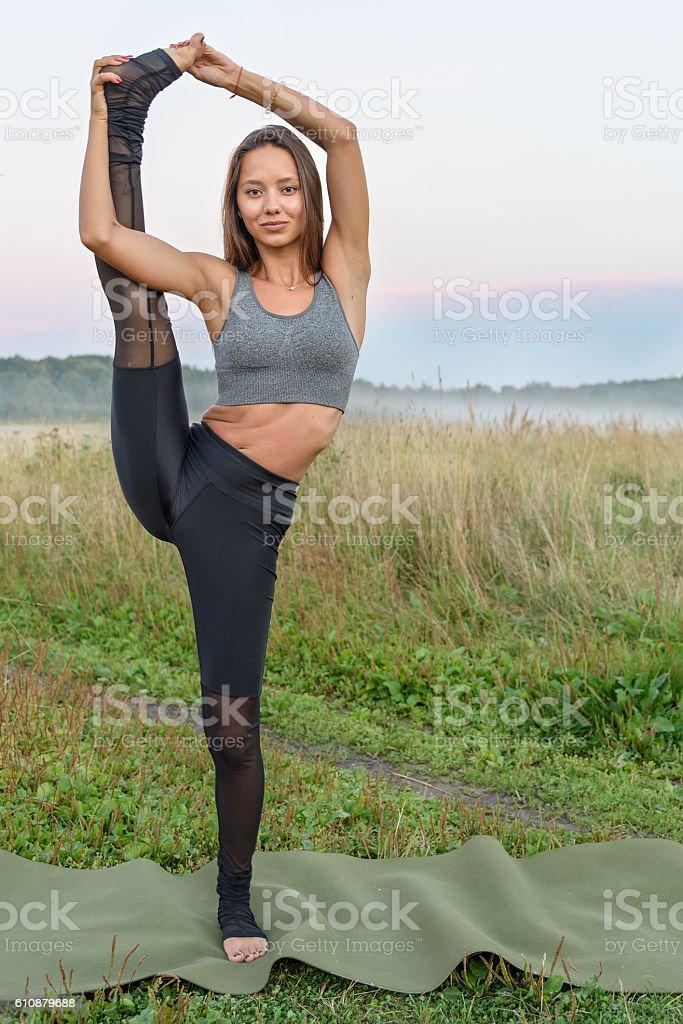 Yoga with one leg up stock photo