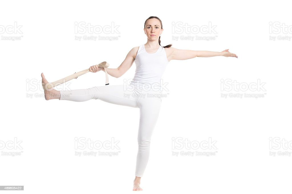 Yoga with props, Extended Hand-To-Big-Toe pose stock photo