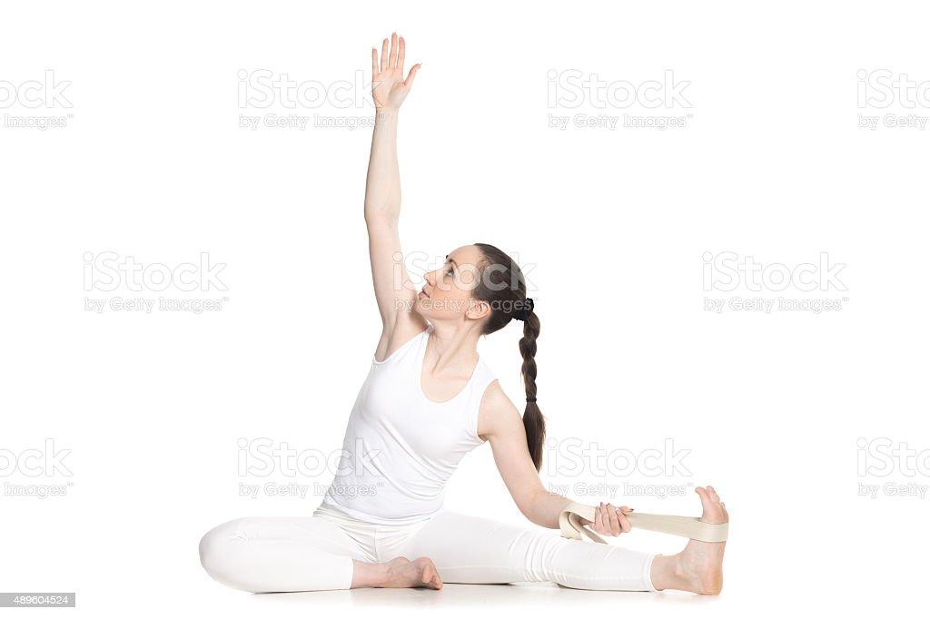 Yoga with props, Parivrtta Janu Sirsasana stock photo