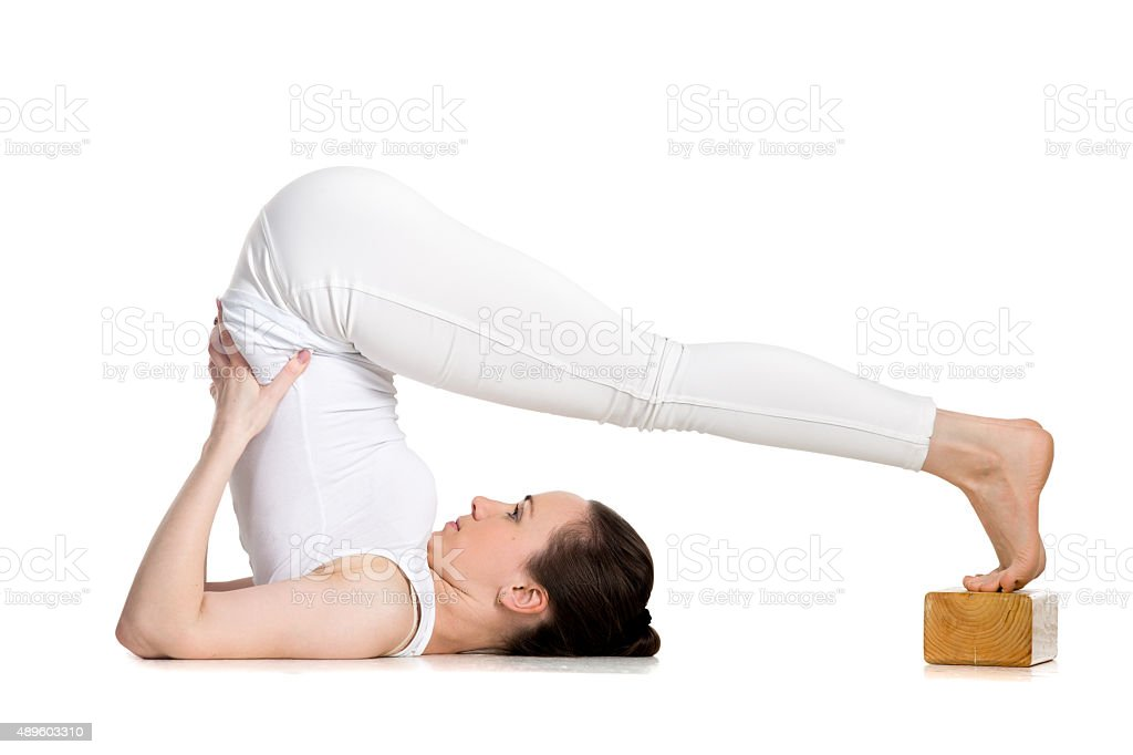 Yoga with props, plough pose stock photo