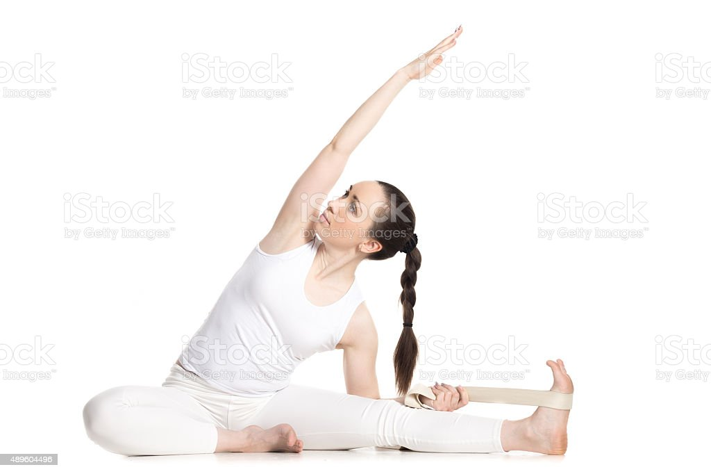 Yoga with props, Revolved Head to Knee pose stock photo