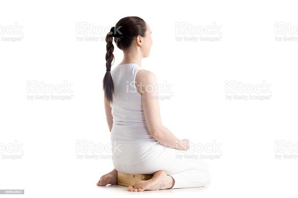 Yoga with props, vajrasana pose stock photo