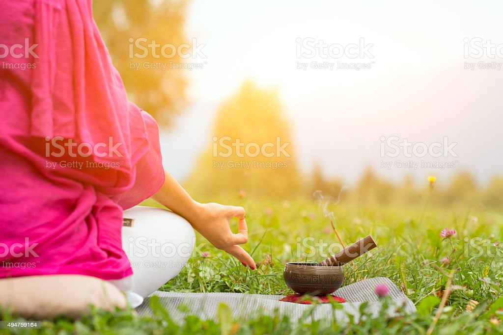 Yoga with Tibetan bell stock photo