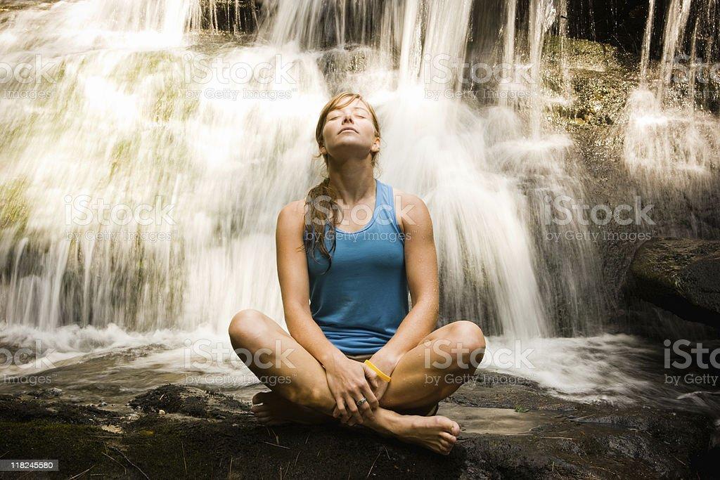 Yoga Woman Before Waterfall stock photo