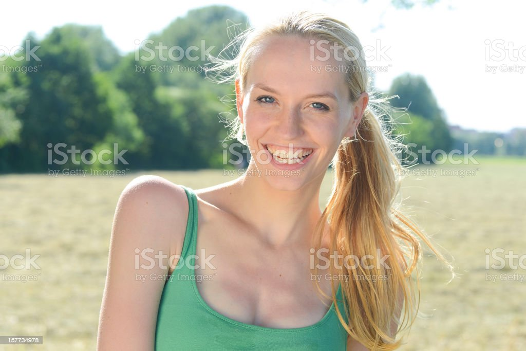 yoga woman in green dress stock photo