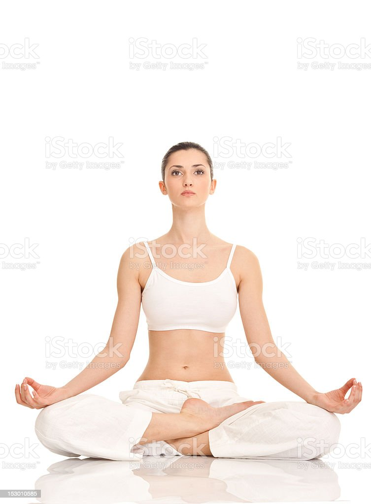 yoga, woman in lotus position stock photo
