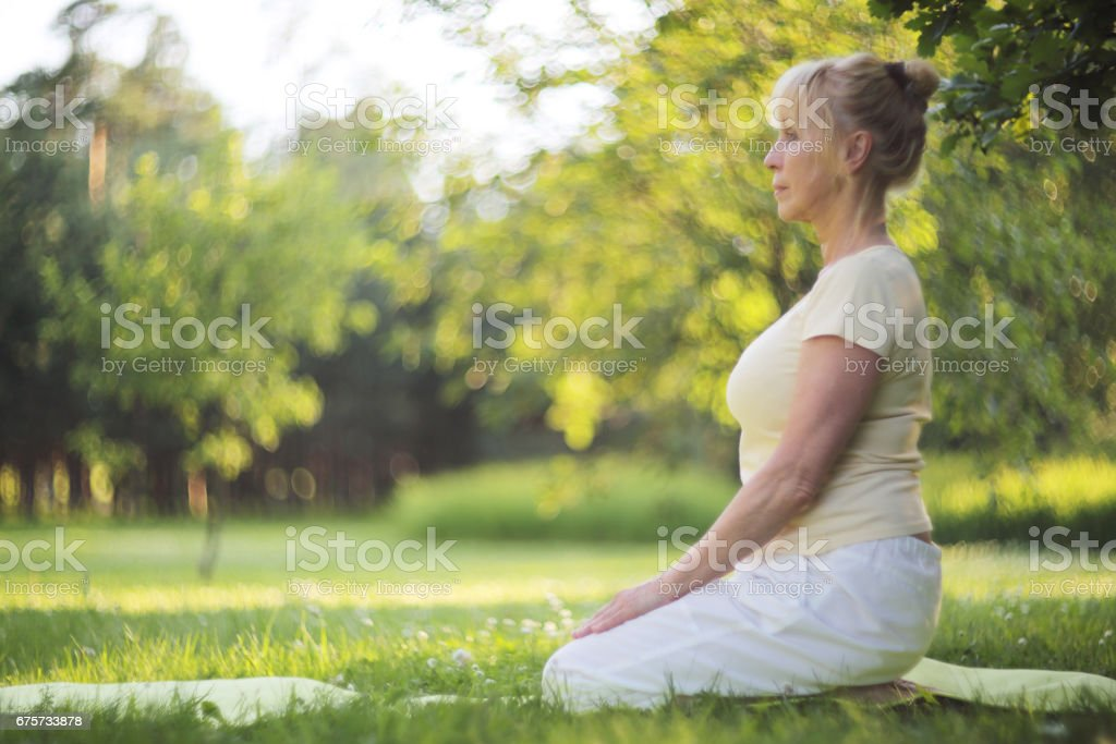 Yoga woman in park stock photo