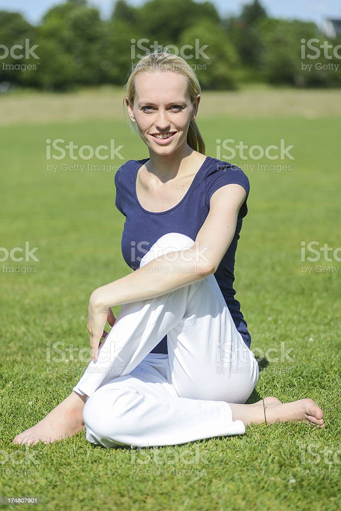 yoga woman in white dress stock photo